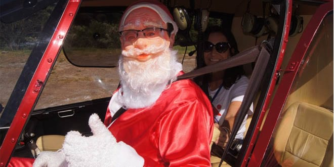 Papai Noel chega a santiago de helicóptero